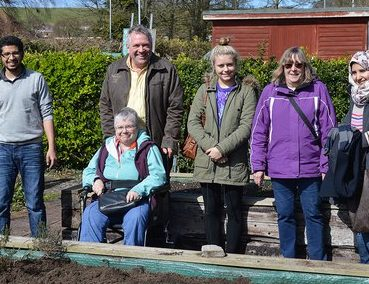 Group standing outside at the Coldean allotment