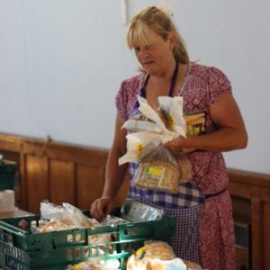 A volunteer distributing food at a food bank