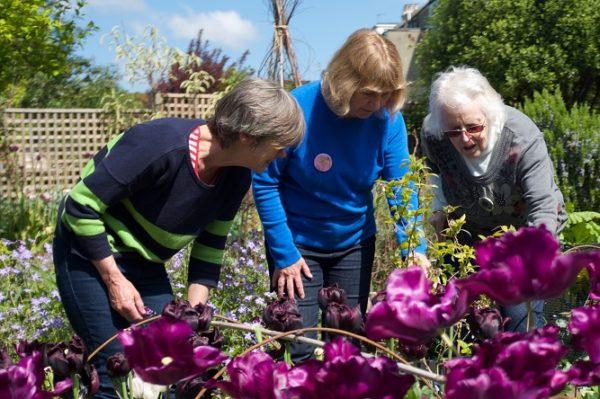 women looking at flowers