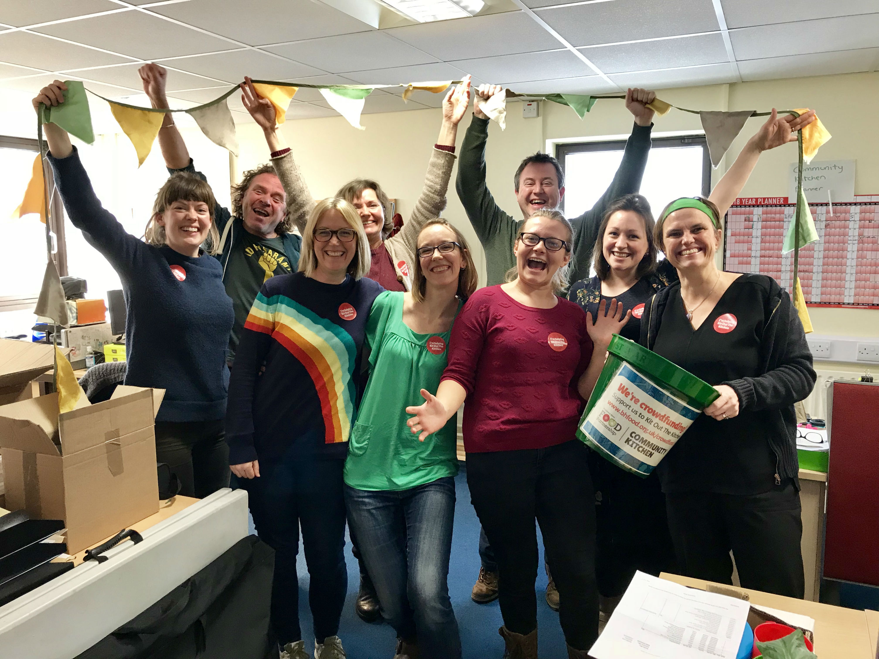 Food Partnership staff cheering in their office