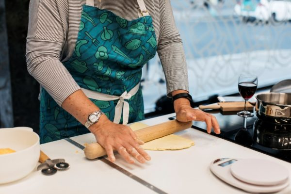 hands rolling out dough with rolling pin