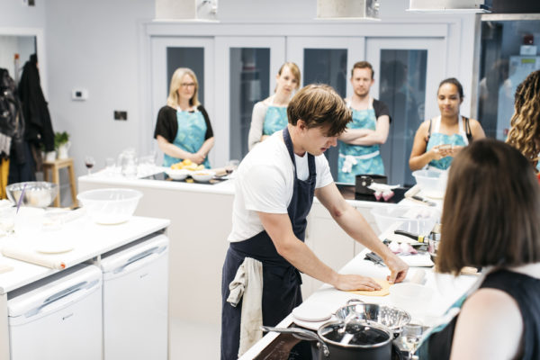 jamie from cincin chef in cookery school kitchen with group of students