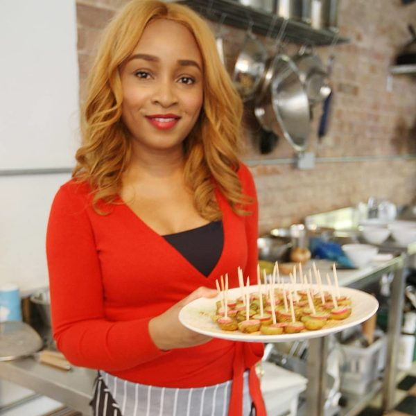 lerato holding plate of food