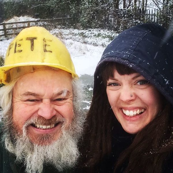 Pete and Rosie, smiling allotment gardeners in the snow